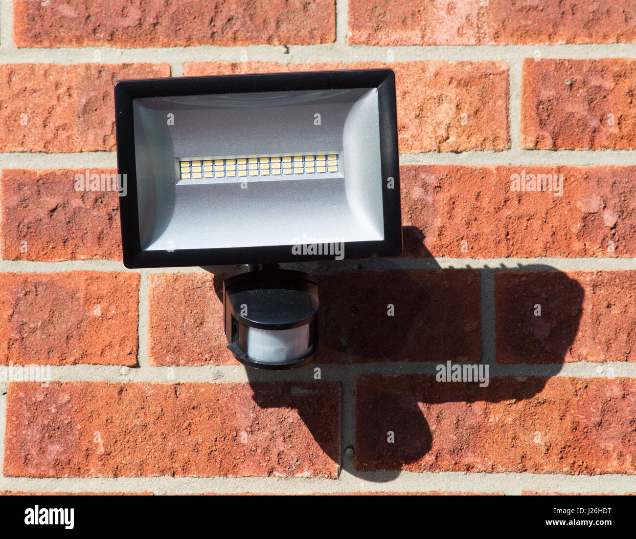 LED floodlight with PIR motion sensor, wall mounted - Stock Image