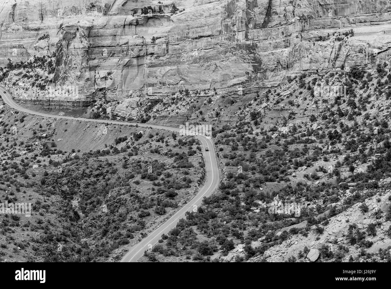 Cars driving the Rim Rock Drive, the road going through the Colorado National Monument, in the Fruita Canyon. The Stock Photo