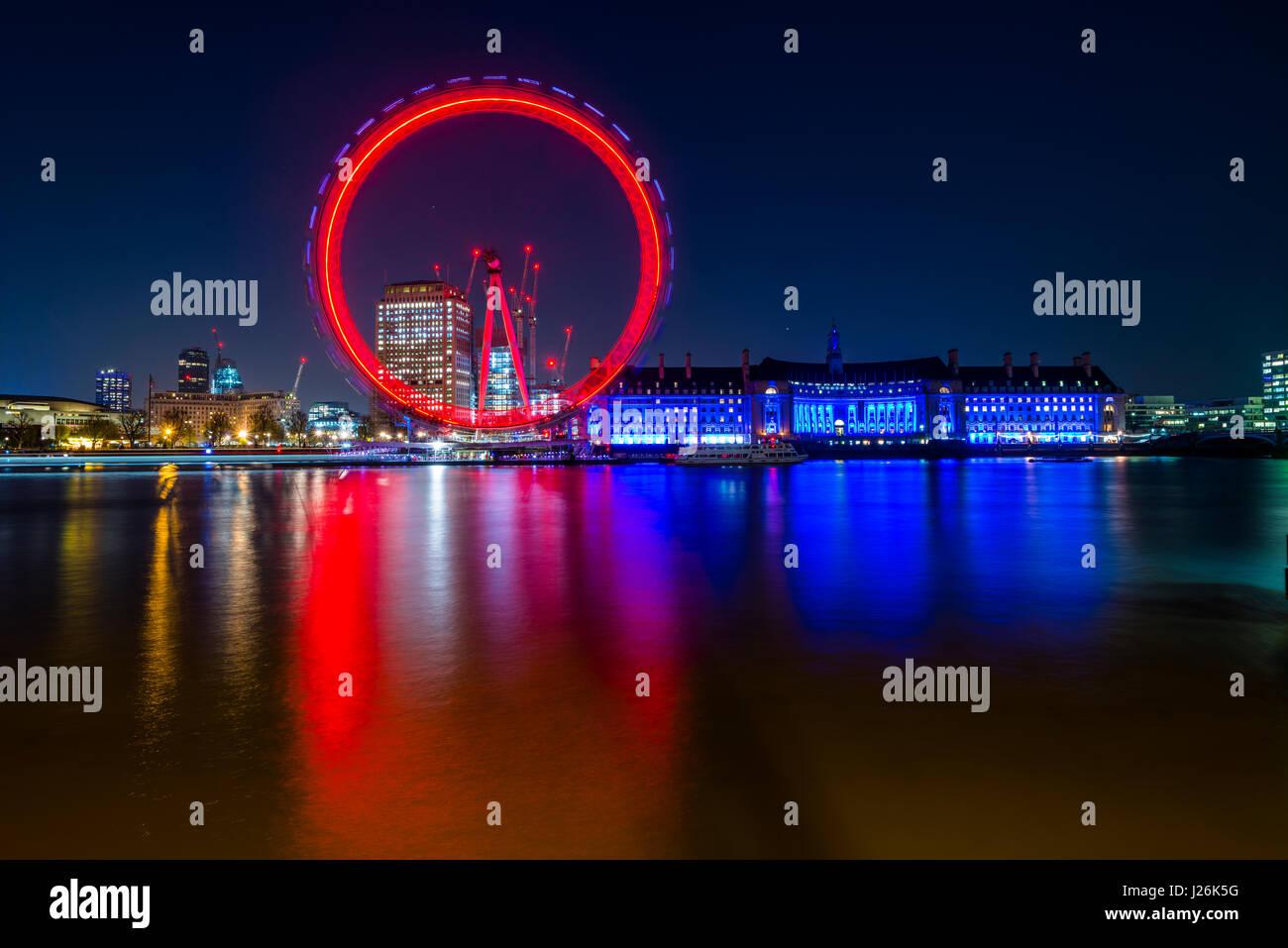 London Eye on the Thames with reflection, illuminated, night shot, London, London region, England, United Kingdom - Stock Image