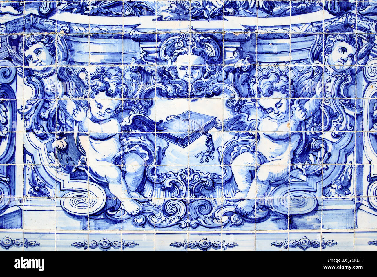 Porto, Portugal - May 13, 2012: Detail of traditional portuguese tilework azulejo on outer wall of the Capela Das - Stock Image