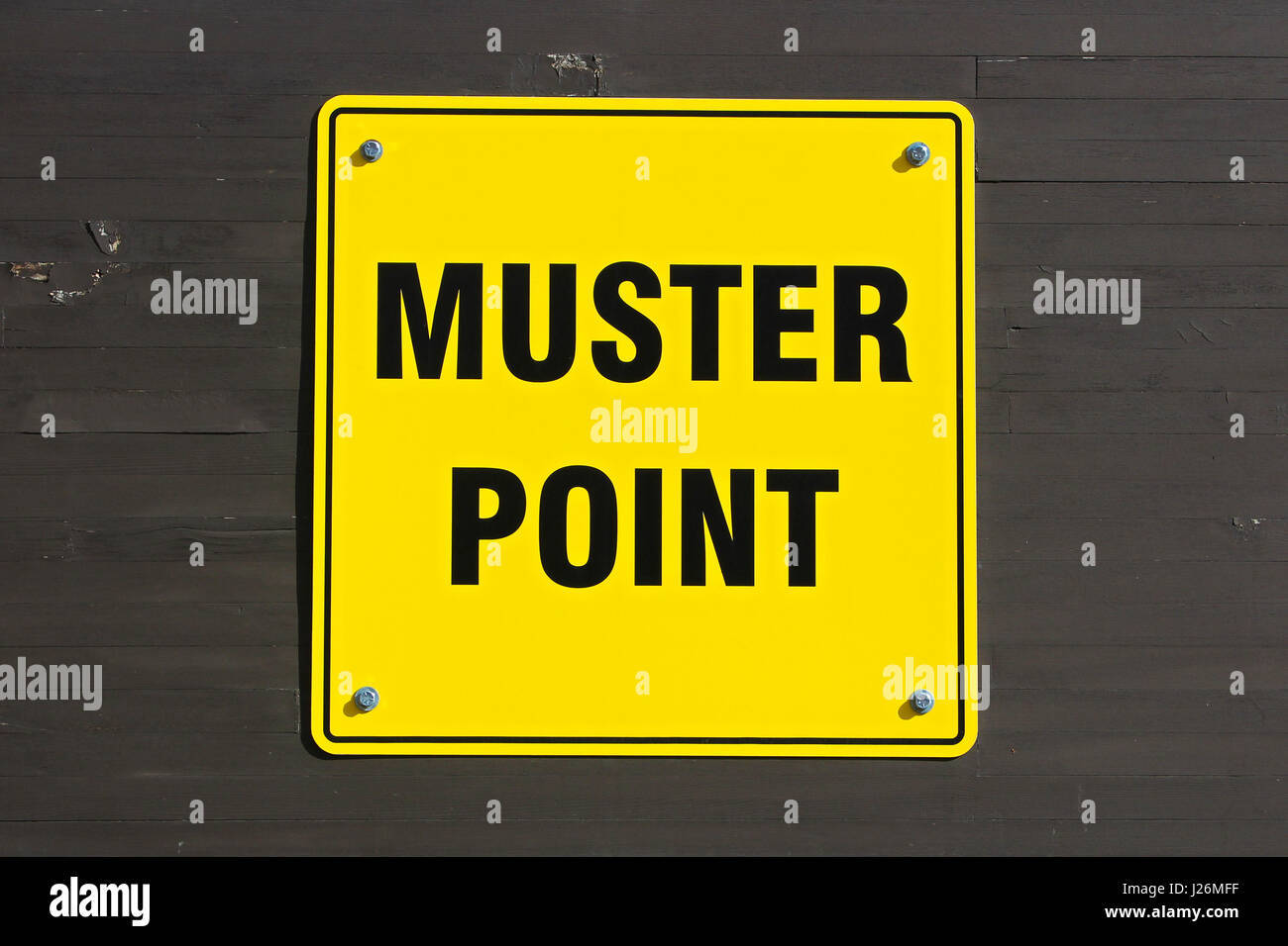Muster point sign on a wall. - Stock Image