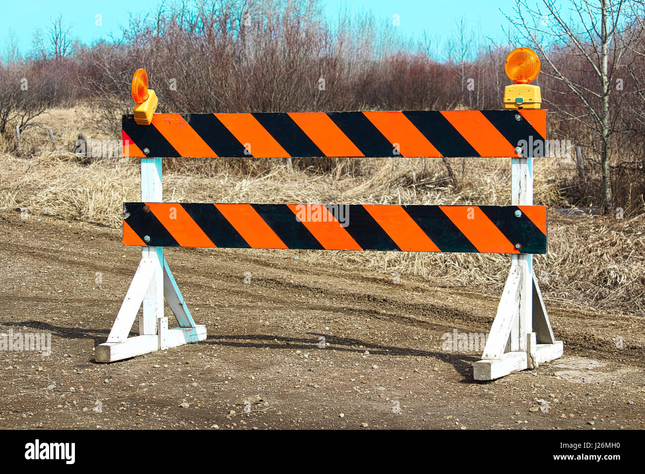 Construction barricade along a country road. - Stock Image