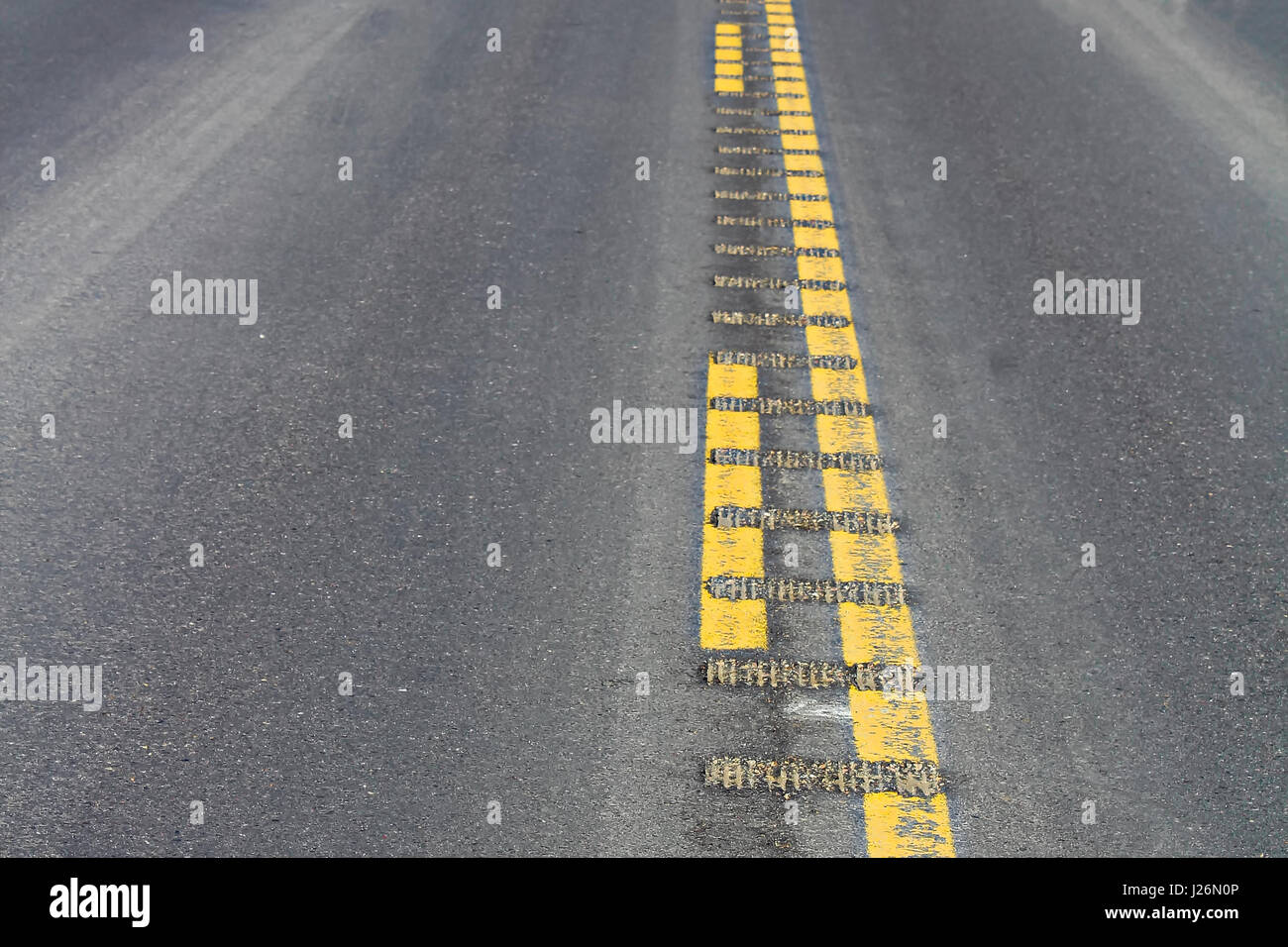 Closeup view of center rumble strips on a highway. Stock Photo