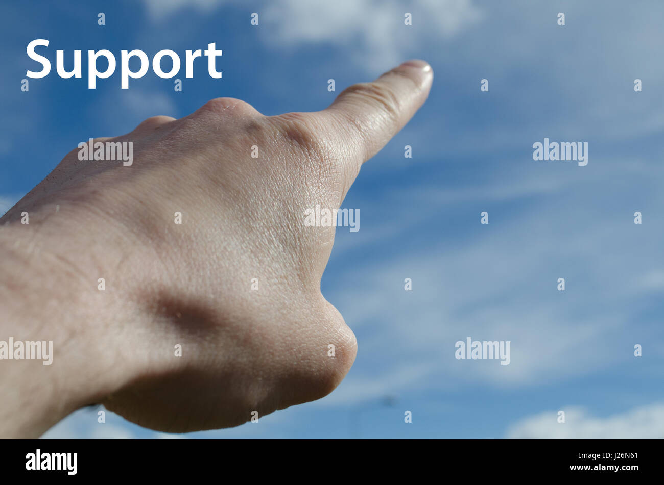 Finger pointing towards blue sky support concept - Stock Image