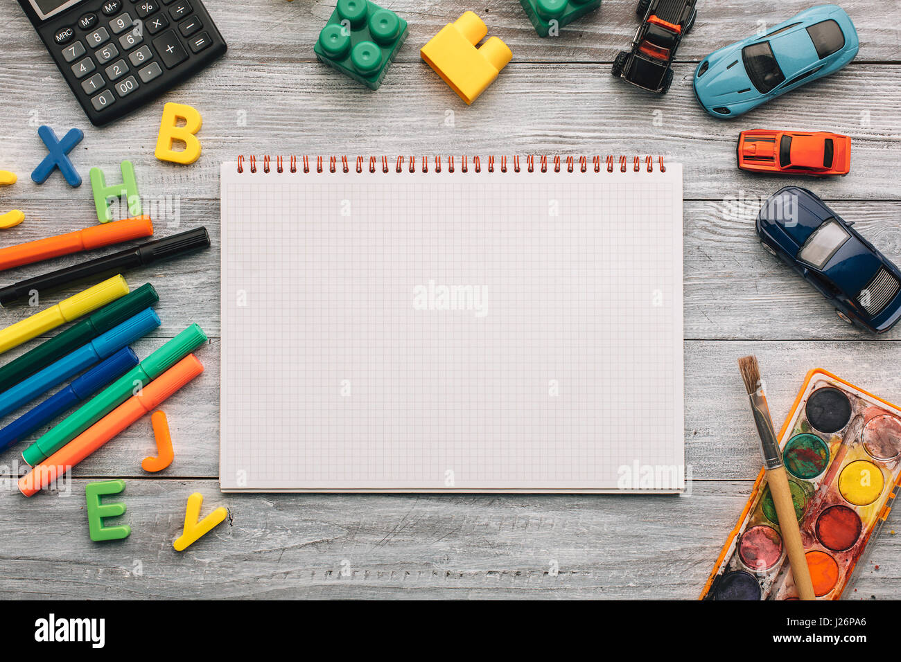 Top View Of Blank Notebook, School Supplies And Toys On A ...