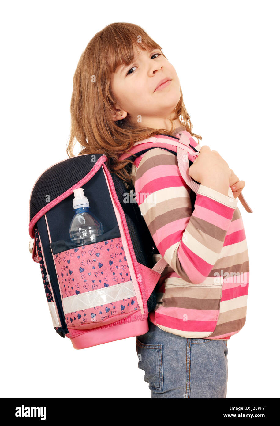 little girl carrying a heavy school bag - Stock Image