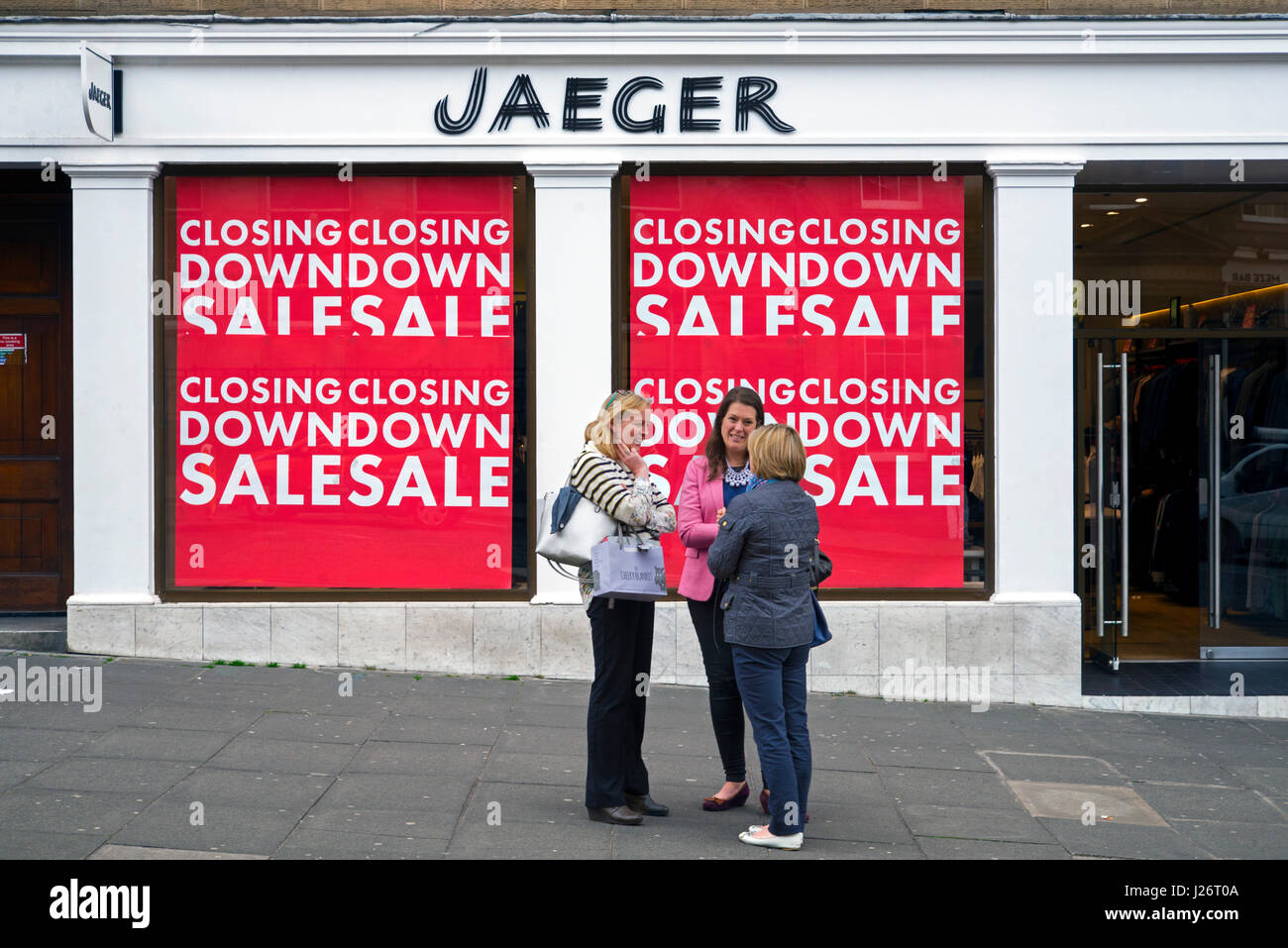 Closing Down Sale signs on a branch of Jaeger ion the corner of  George Street and Dundas Street, Edinburgh, Scotland, - Stock Image