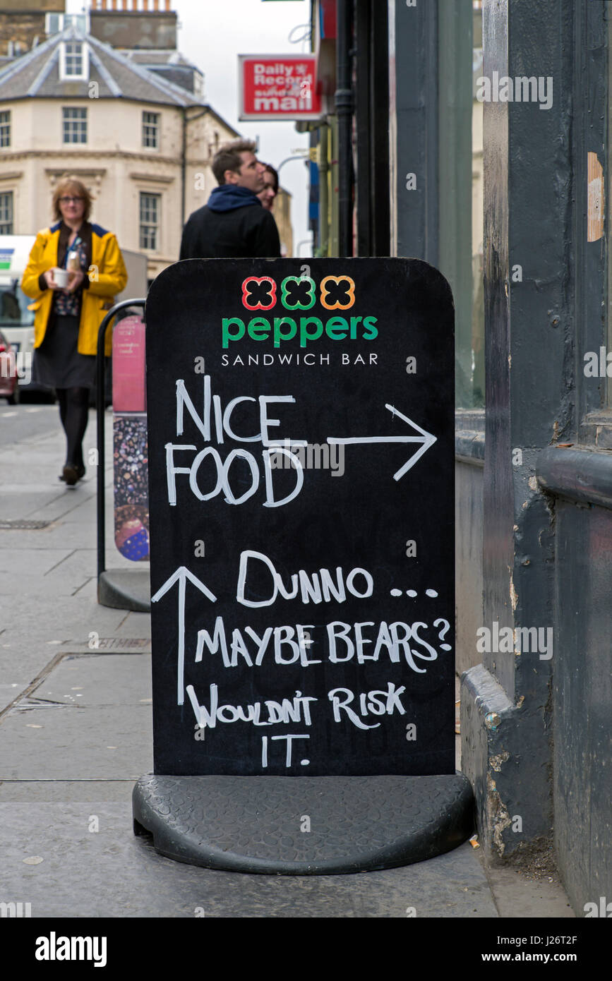Amusing sign advertising Peppers Sandwich Bar in Edinburgh's West Port. - Stock Image