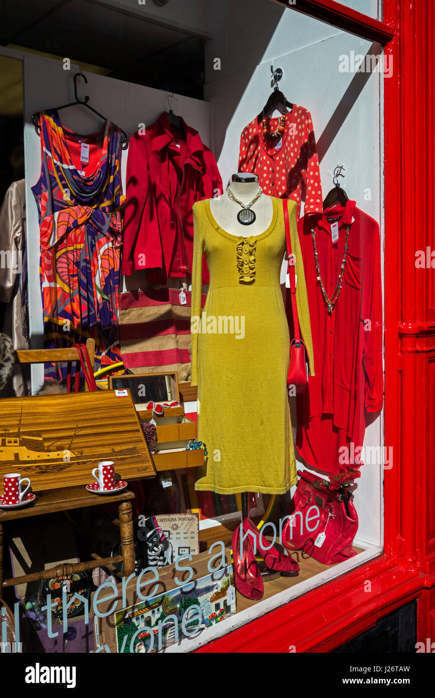 Secondhand  dresses for sale in the window of a Shelter charity shop in Edinburgh. - Stock Image