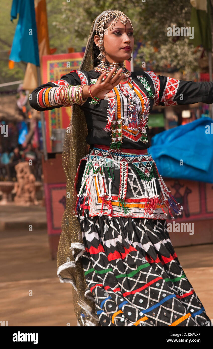 77c879b6c036 Woman in traditional black costume of the Kalbelia Tribe from Rajasthan,  performing at the annual Sarajkund Mela in Haryana in India.
