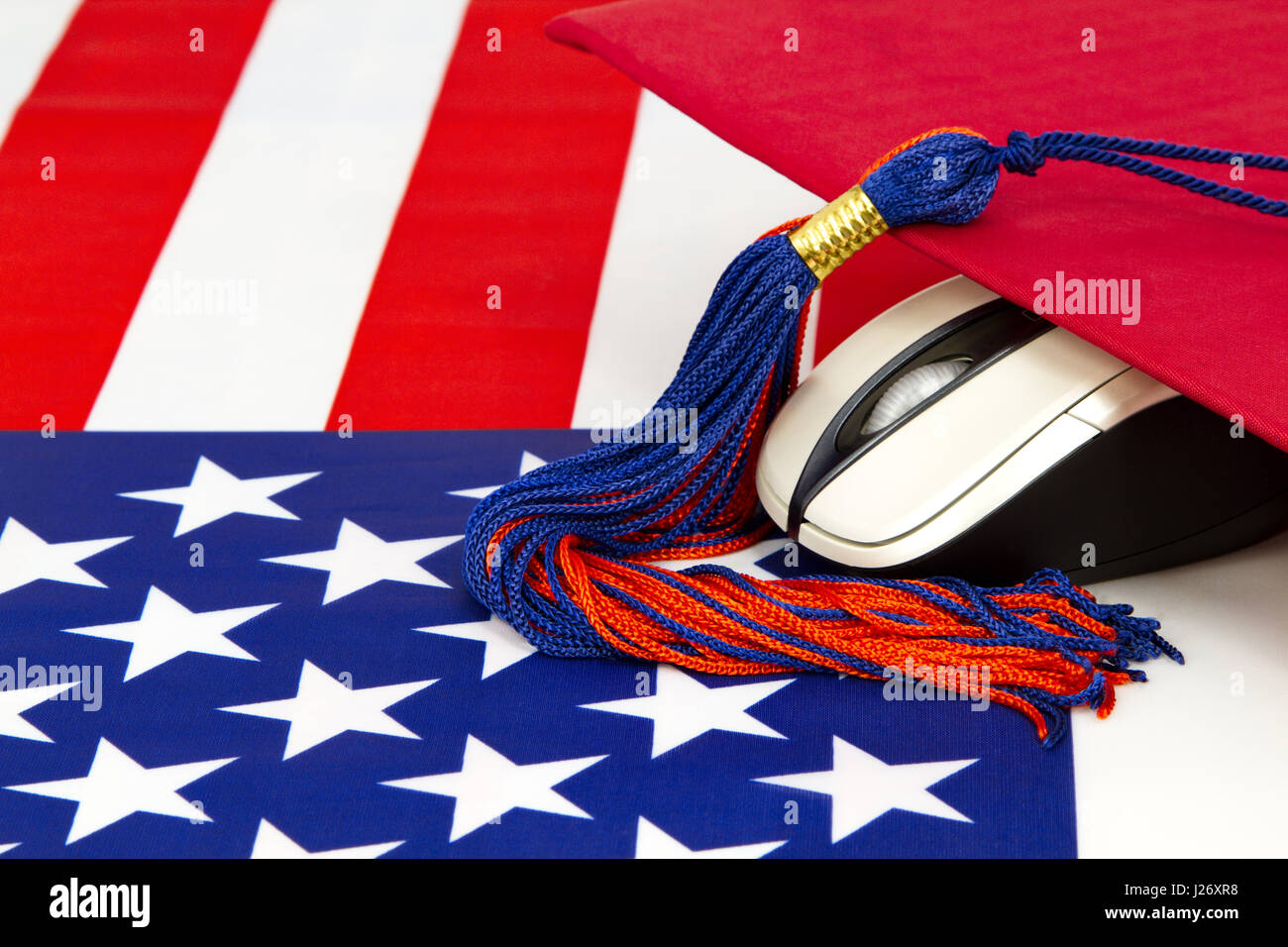 Graduation cap and tassel with computer mouse and American flag design reflects modern priorities.  21st century - Stock Image
