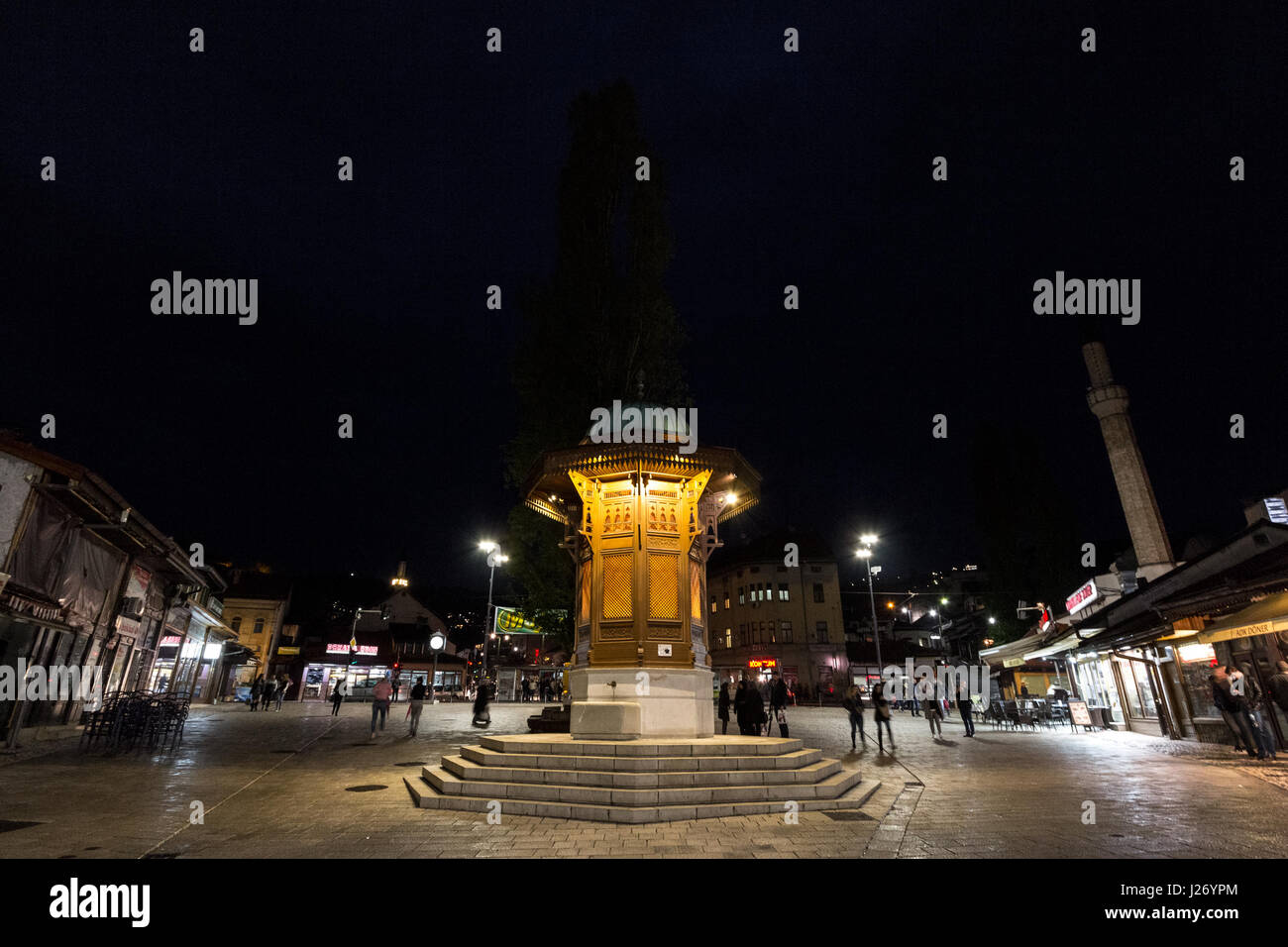 SARAJEVO, BOSNIA HERZEGOVINA - APRIL 16, 2017: Sebilj fountain, on Bacarsija district,  at night. This fountain - Stock Image