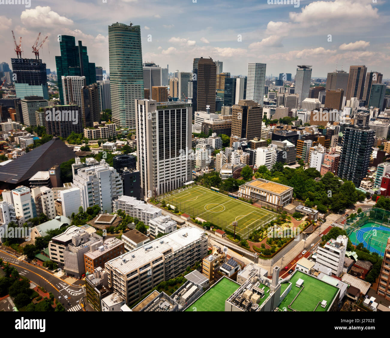TOKYO, JAPAN - JUNE 10: View at modern skyscrapers in Roppongi district in Minato, Tokyo at June 10, 2015. This - Stock Image