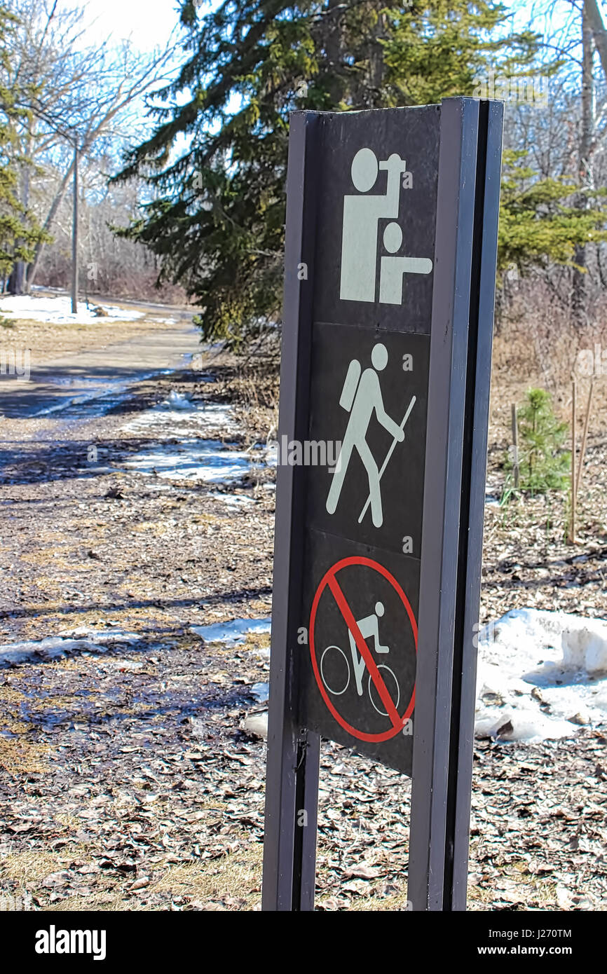 Hiking trail marker on the edge of a path. - Stock Image