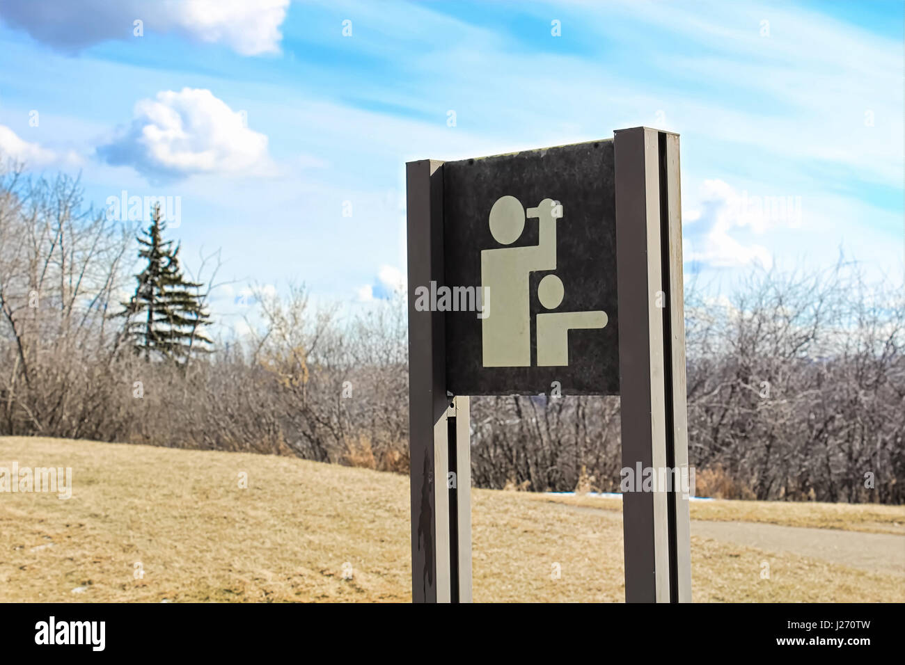 A viewpoint sign on the edge of a hiking trail. - Stock Image