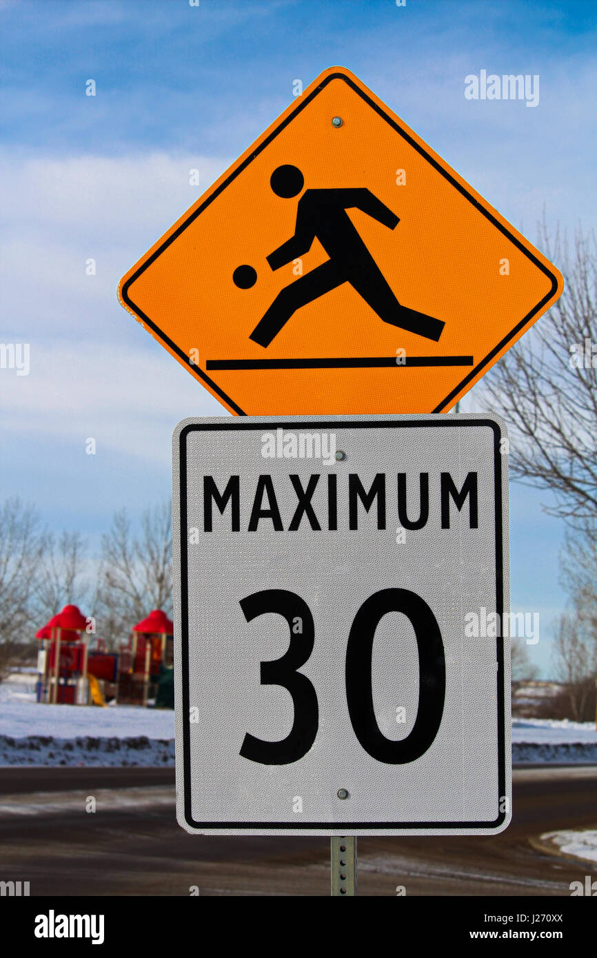 Playground Zone with Maximum Speed Limit Sign - Stock Image