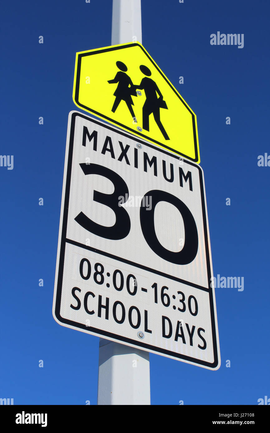 Speed Limit Sign in School Zone - Stock Image