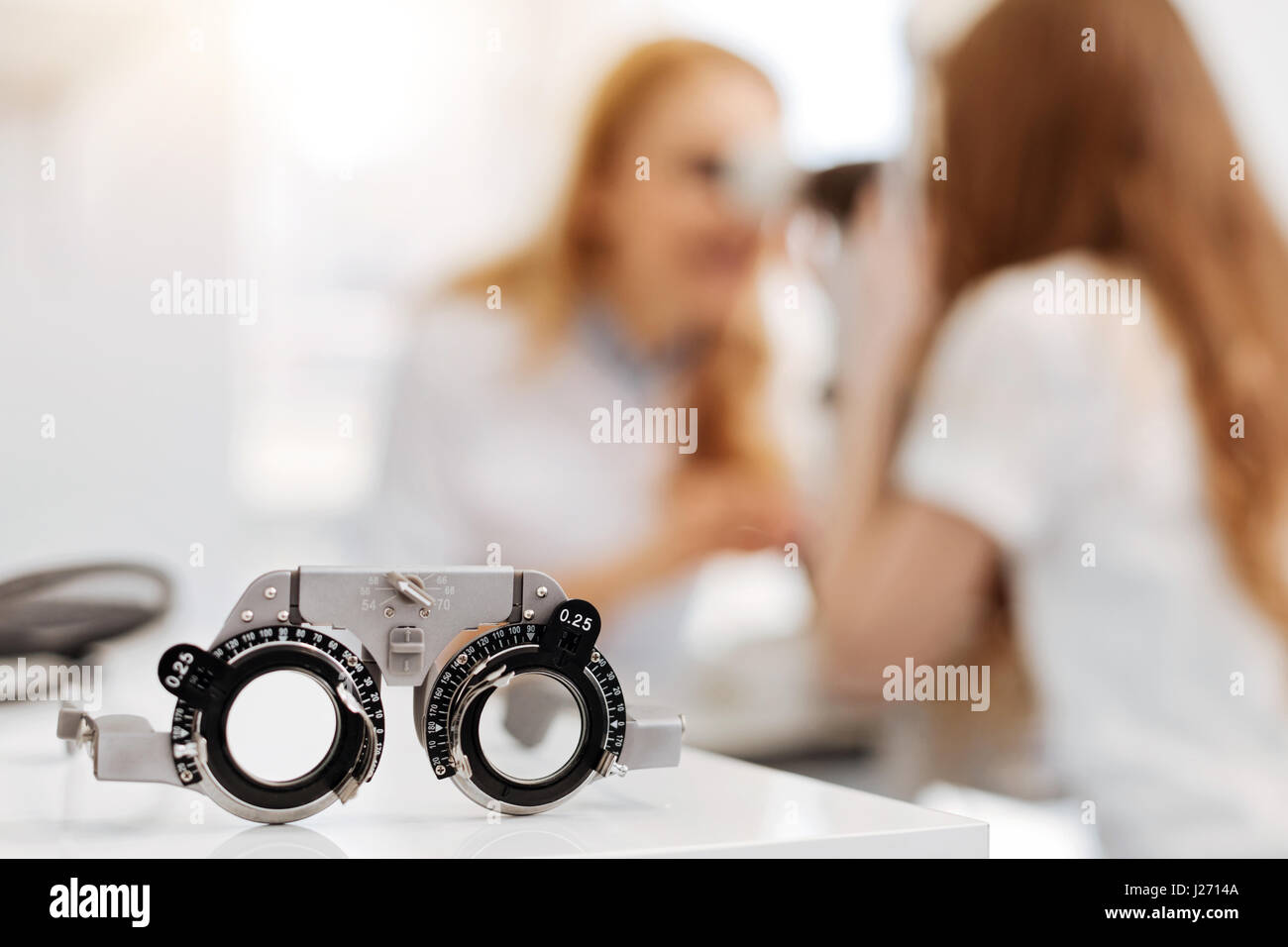 Professional prominent ophthalmologist doing her job - Stock Image