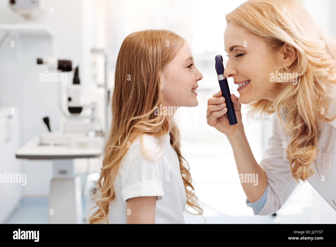 Prominent eye specialist using ophthalmoscope - Stock Image