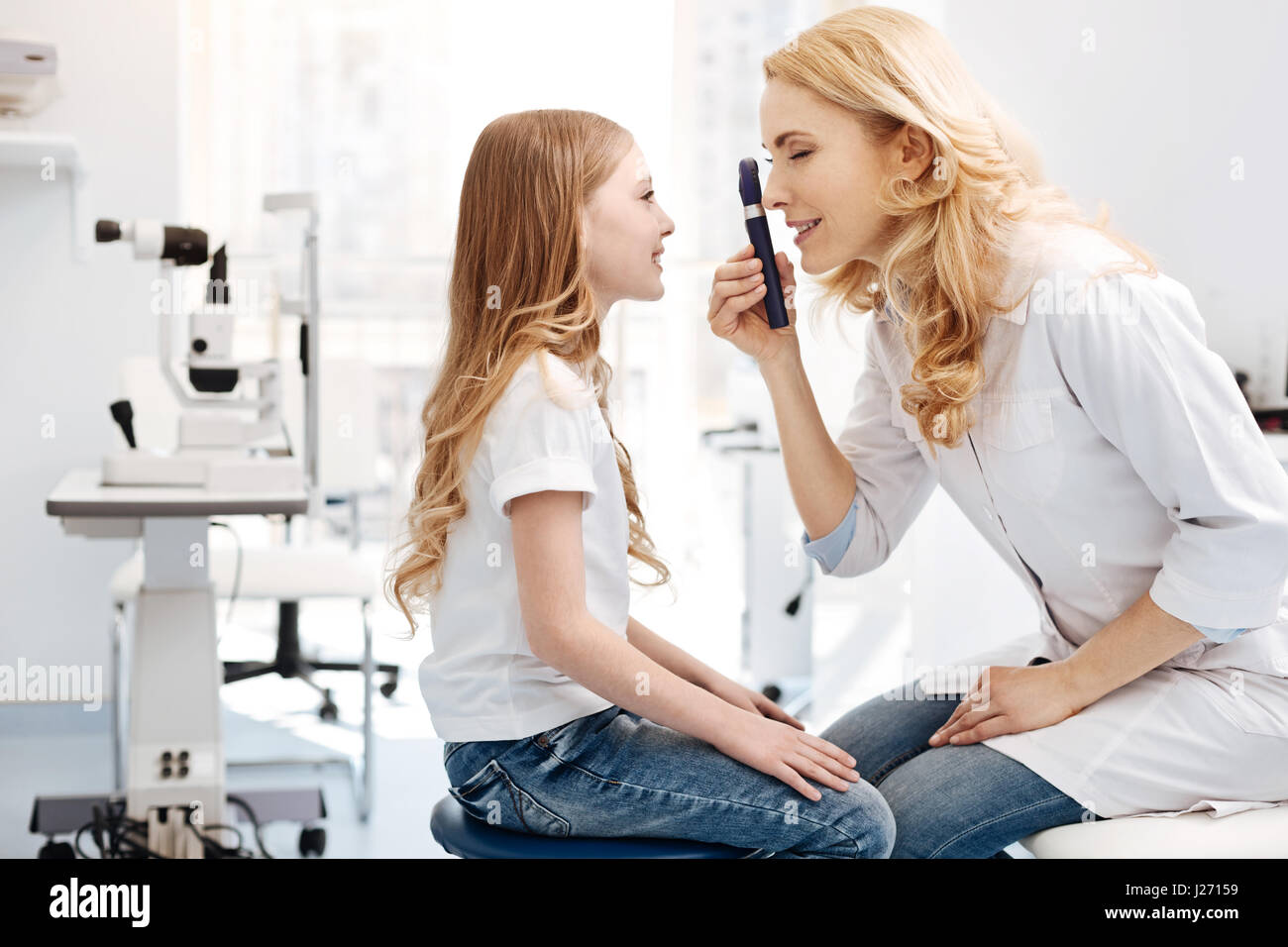 Capable private doctor running a routine checkup - Stock Image