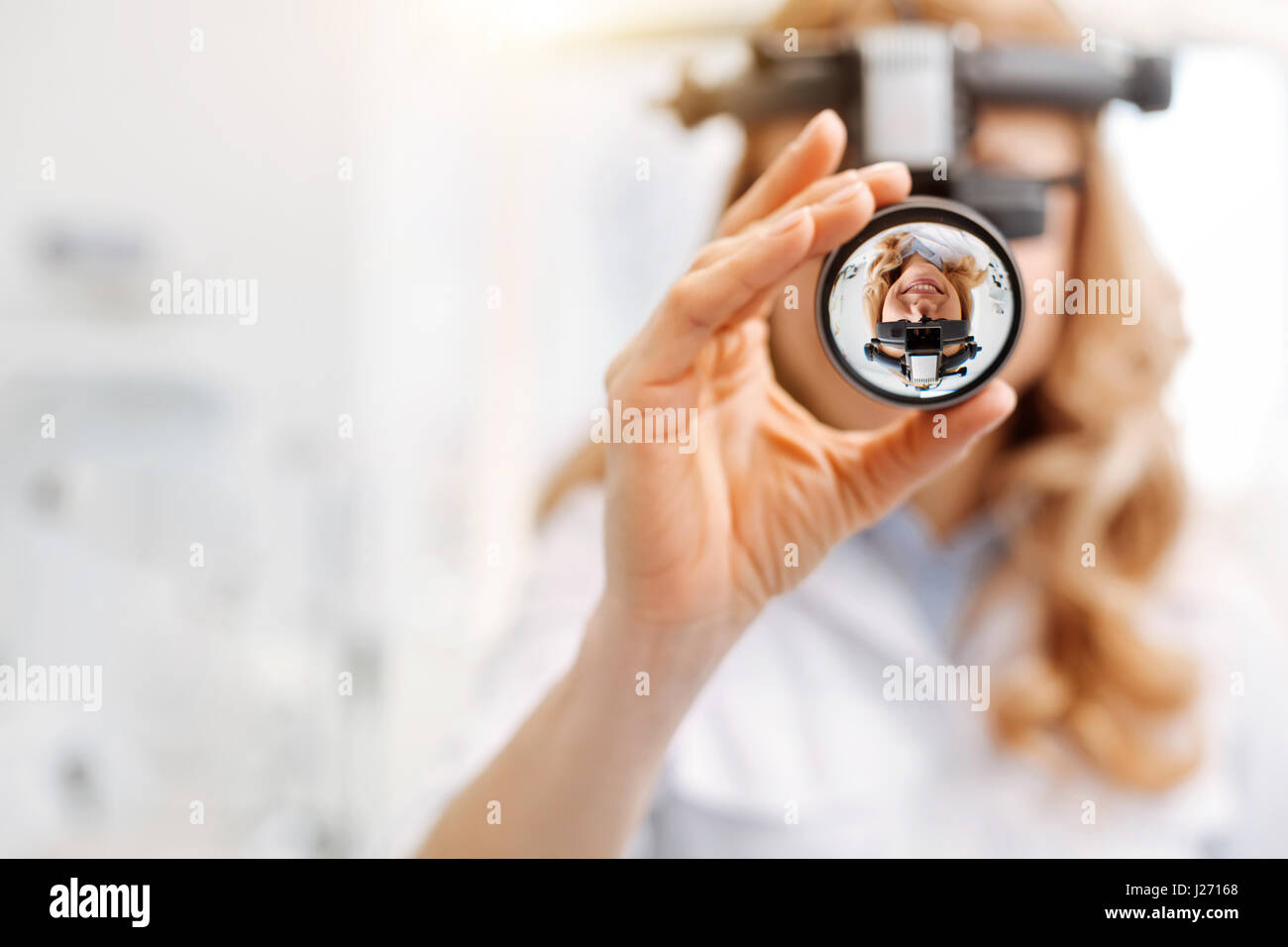 Busy young specialist using special lens - Stock Image