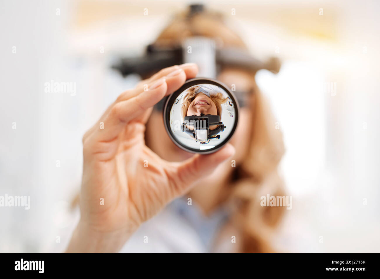 Focused scrupulous ophthalmologist doing a professional checkup - Stock Image
