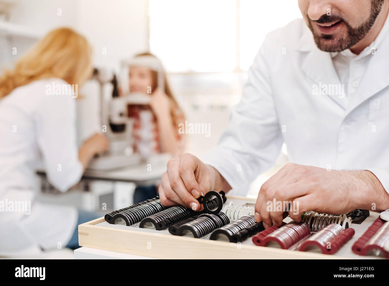 Professional ophthalmologist ordering the lenses in spectacle box - Stock Image