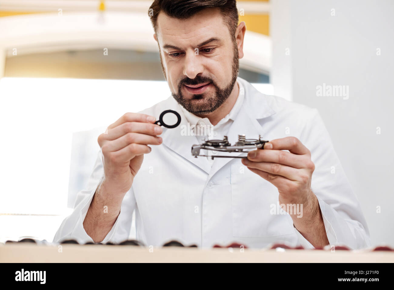 Dedicated professional working with tools carefully - Stock Image