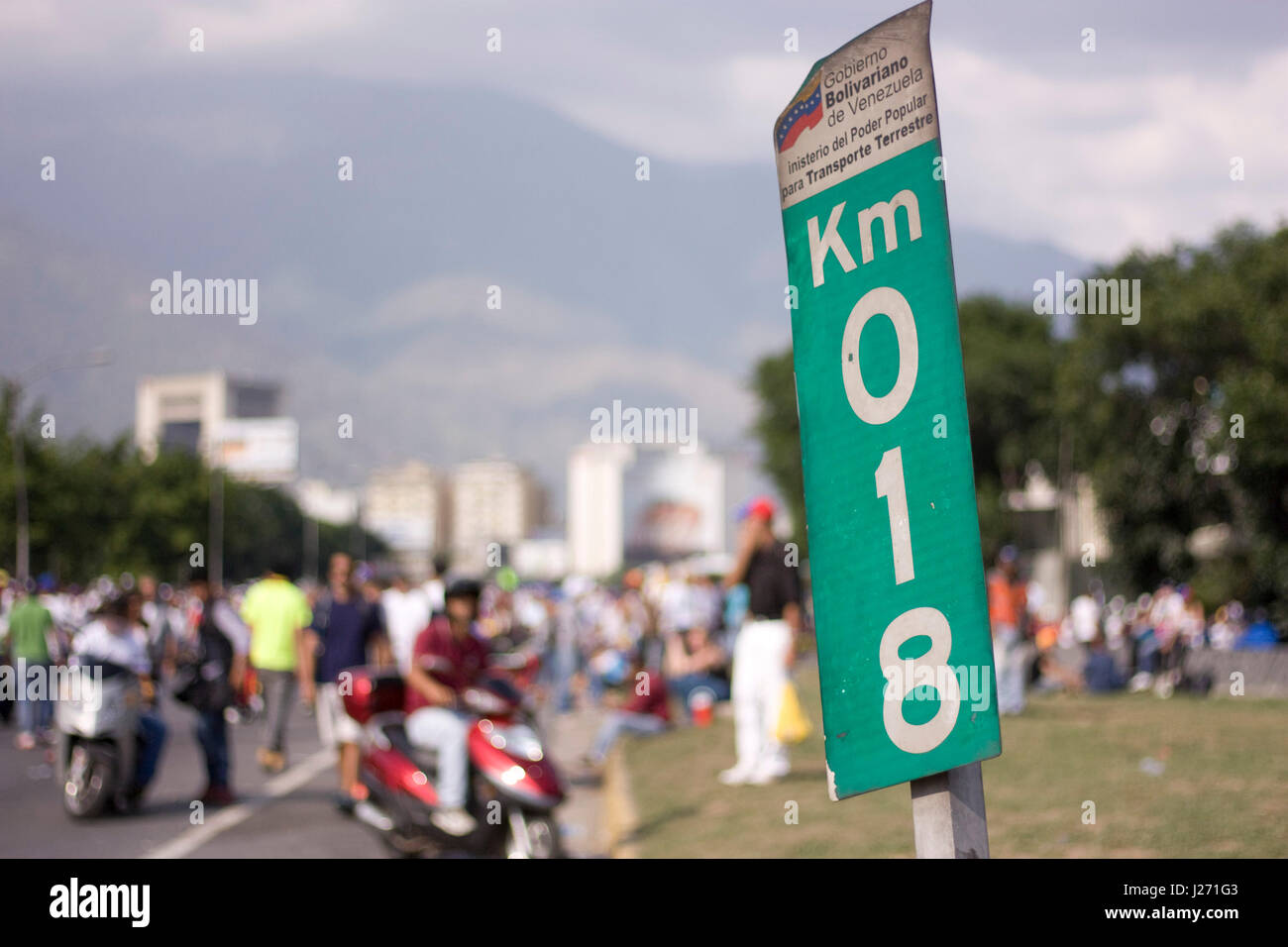 A protest in Caracas against the government of Nicolas Maduro on a highway. - Stock Image