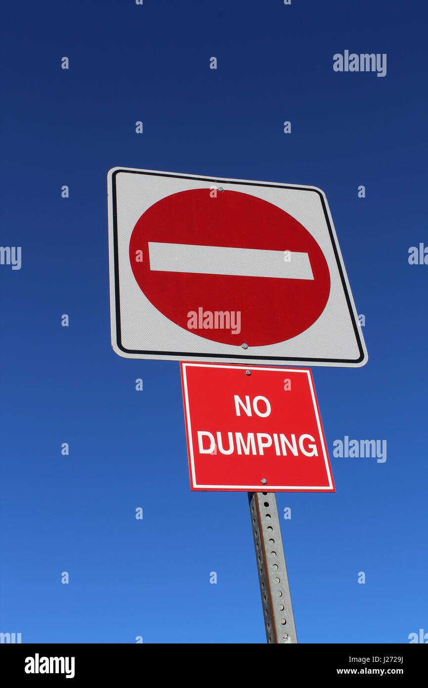No Entry or Dumping Sign Against Blue Sky. - Stock Image