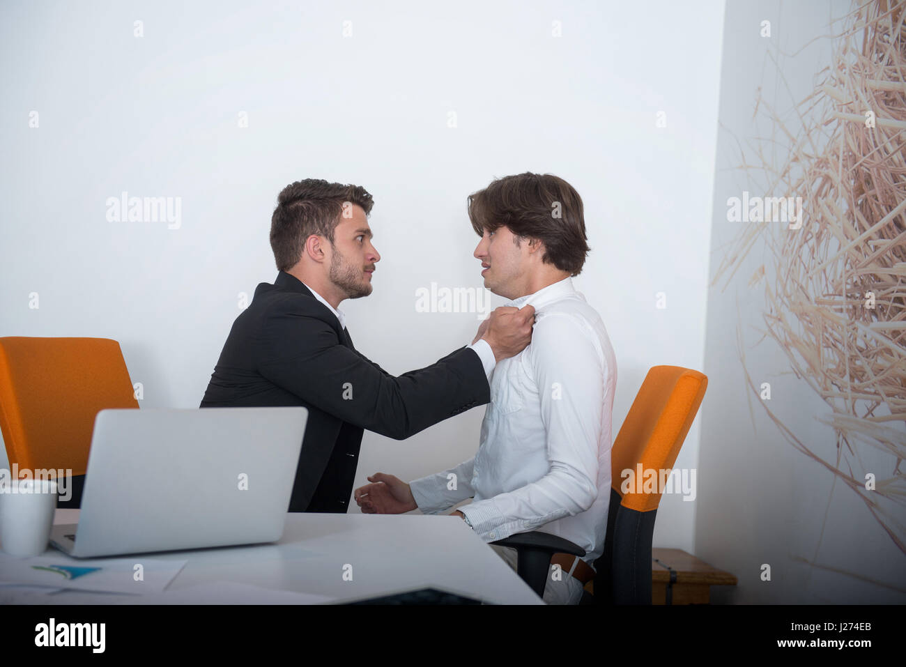 Two angry business colleagues during an argument - Stock Image