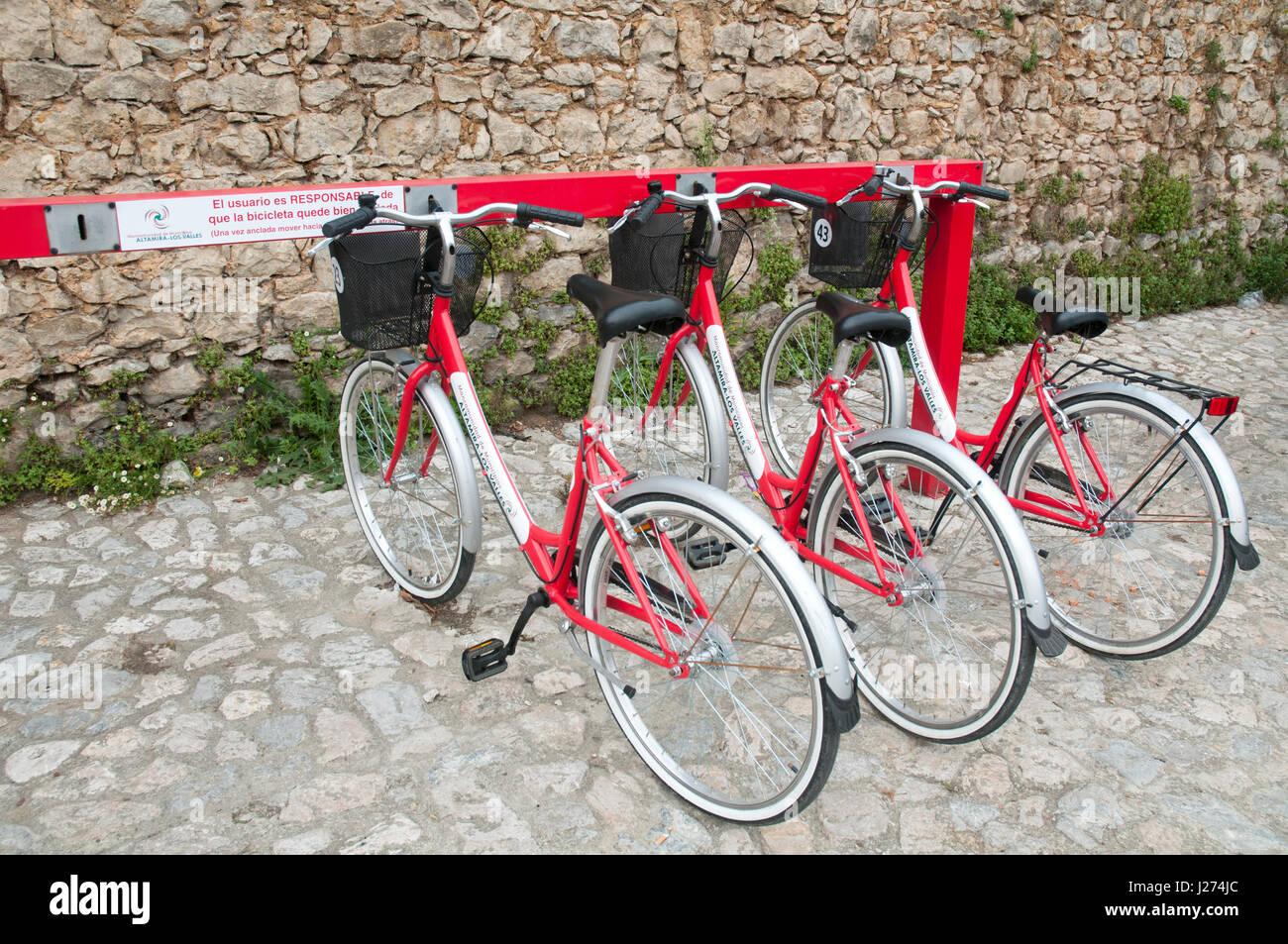 Hire bikes. Santillana del Mar, Cantabria, Spain. - Stock Image