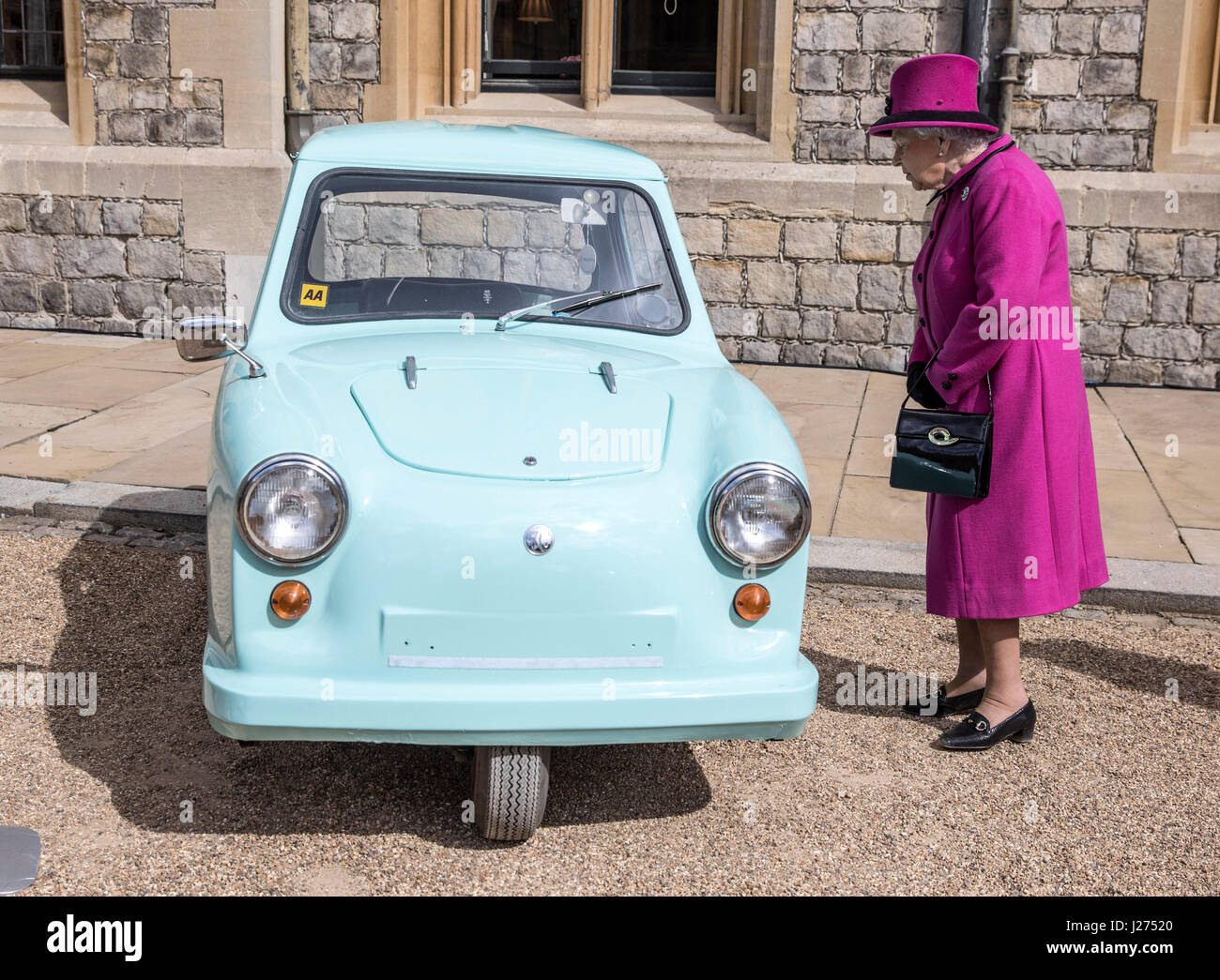 Queen Elizabeth Ii Stands Next To A Classic Invacar Invalid Carriage