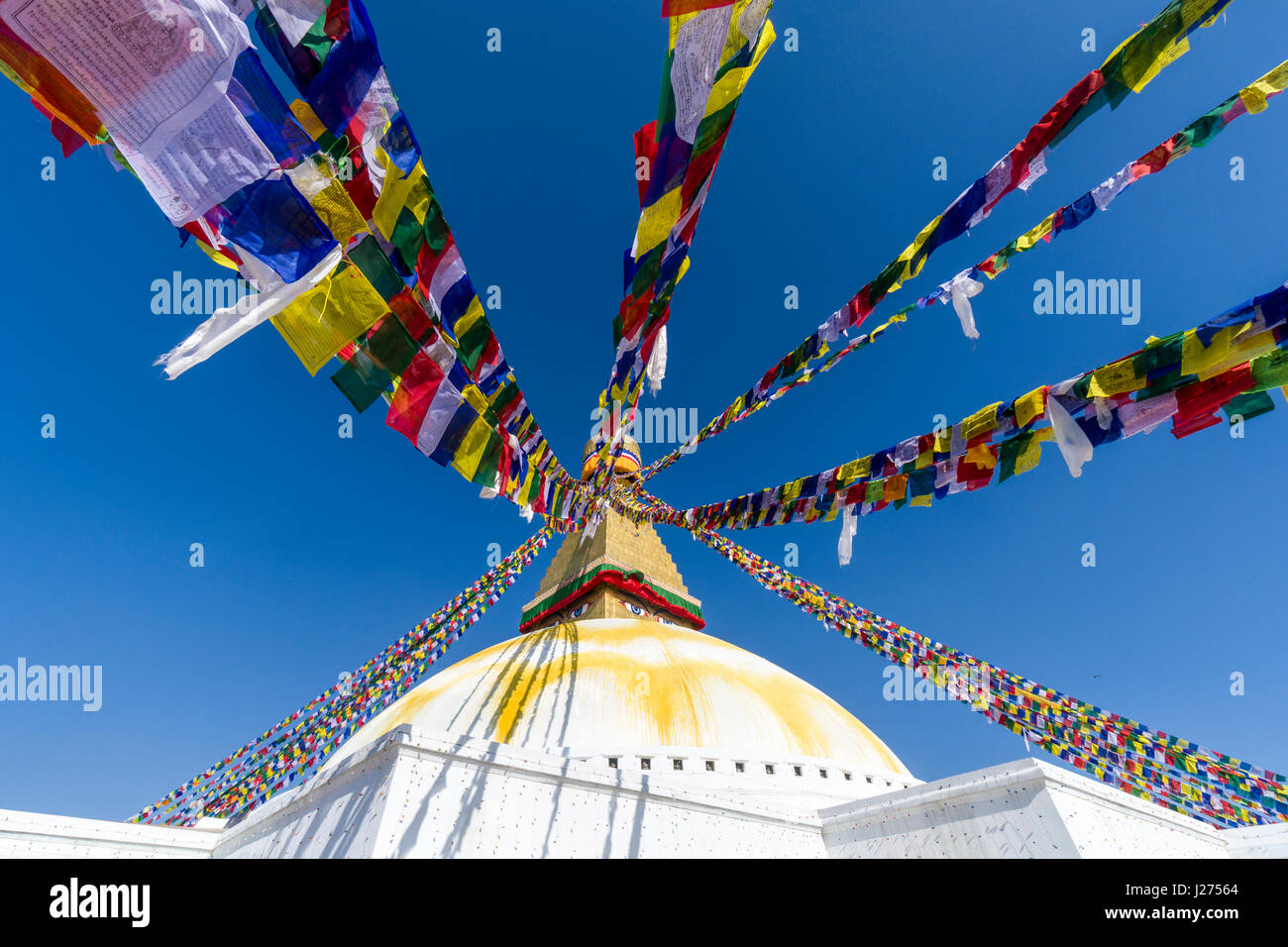 The Bouda Stupa is the centre of buddhist spirituality in town, the white building is decorated by colorful tibetean - Stock Image