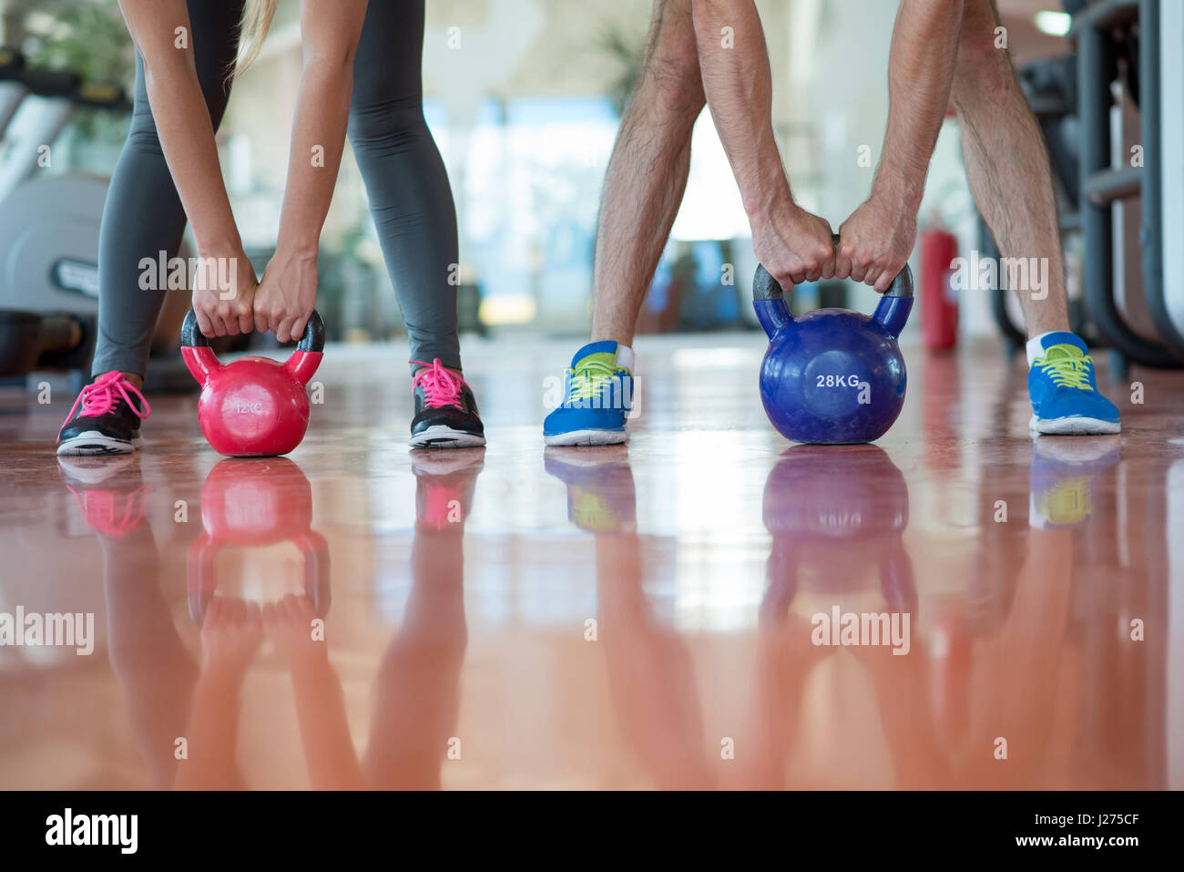 Fit people working out in fitness class at the gym - Stock Image