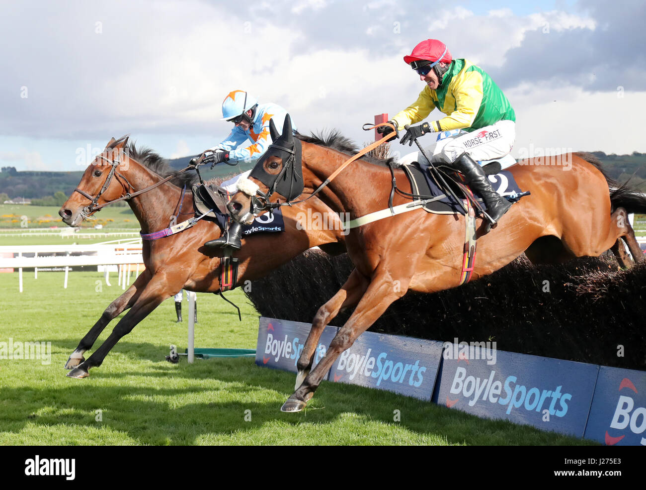 Jockey Robbie Power on board Fox Norton (nearside) wins the BoyleSports Champion Chase during day one of the Punchestown - Stock Image