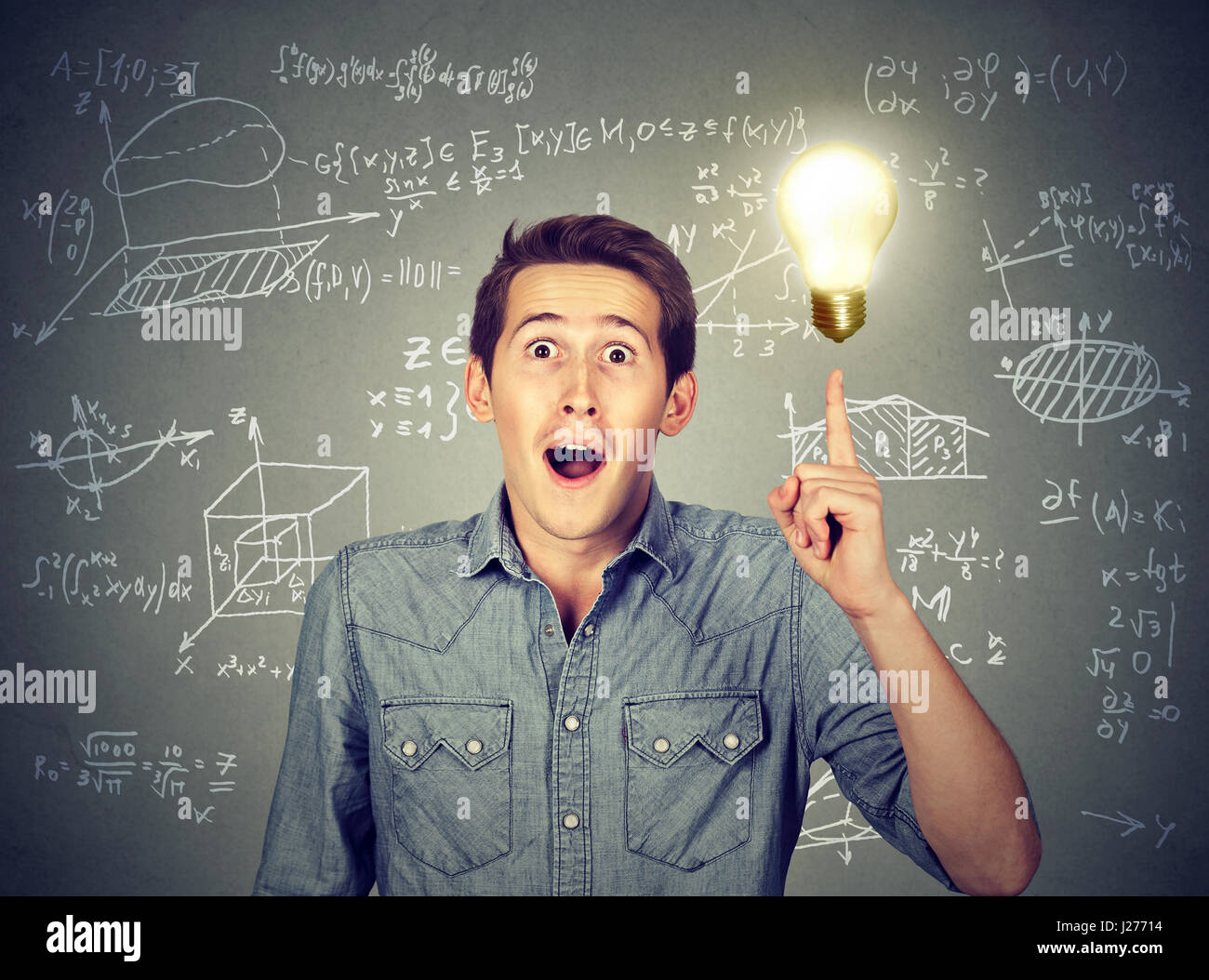 smart student with idea light bulb and various high school maths and science formulas on background Stock Photo