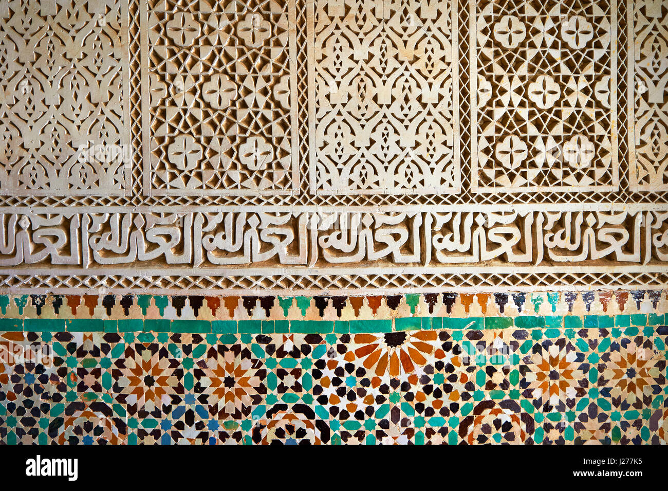 Berber Mocarabe Honeycomb work plaster decorations and Berber design tiles of the Mauseleum of Moulay Ismaïl - Stock Image