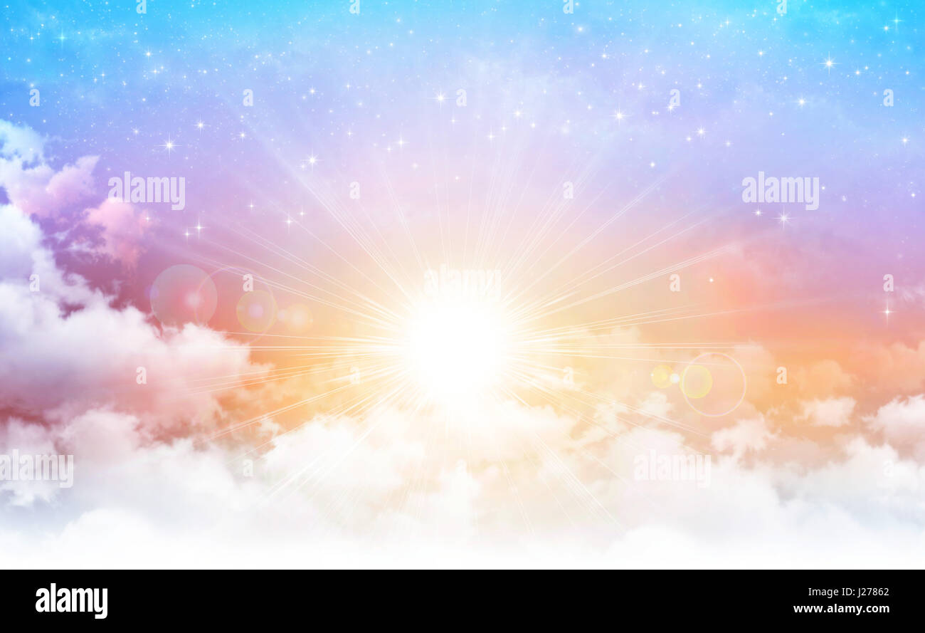 Early morning sky with the sun breaking through white clouds, stars shining behind. - Stock Image