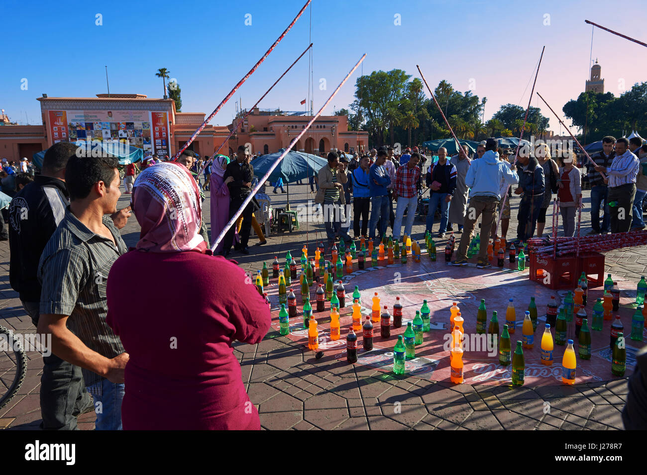 People relaxing in the Jemaa el-Fnaa square in  Marrakech, Morocco - Stock Image