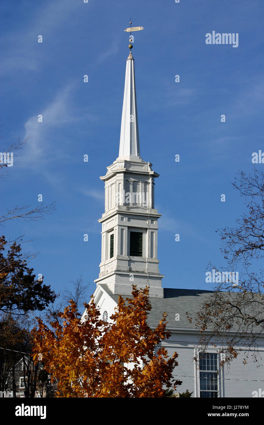 Steeple of the First Congregational Church, Princeton, Massachusetts, rising into a blue sky on an Autumn day in Stock Photo