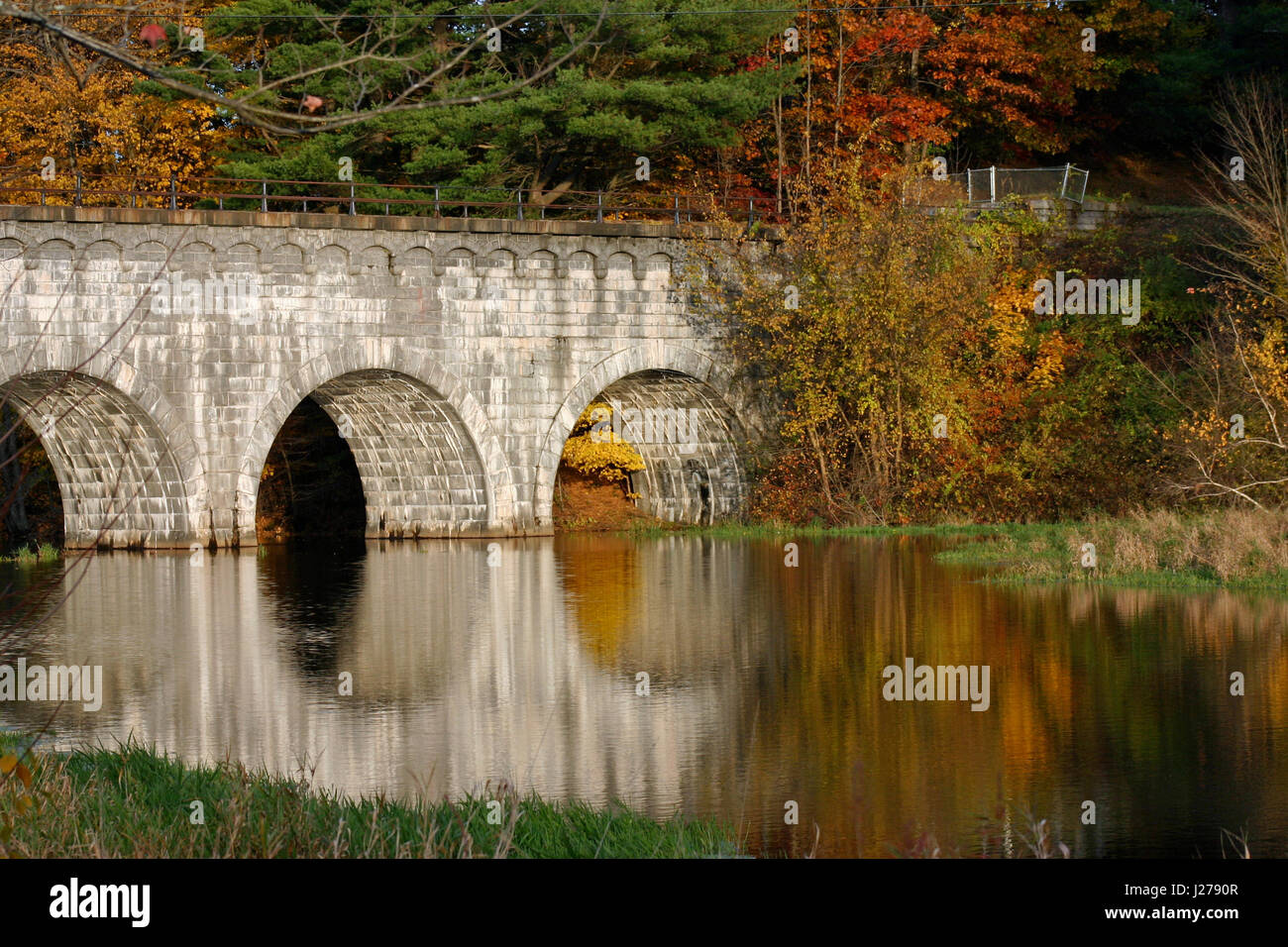 Wachusett Aqueduct Bridge on the Assabet River, Northborough, Massachusetts, in Autumn Stock Photo