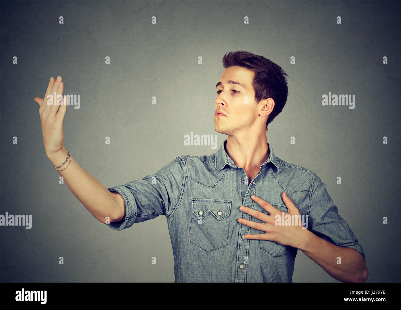 Arrogant bold self important stuck up man with napoleon complex, short man syndrome isolated on gray background. - Stock Image