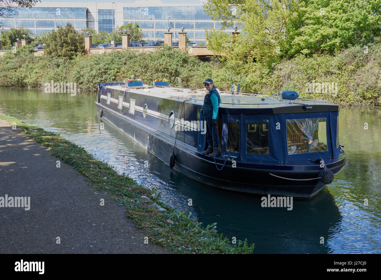 Canal boat being moored on the river Brent - Stock Image