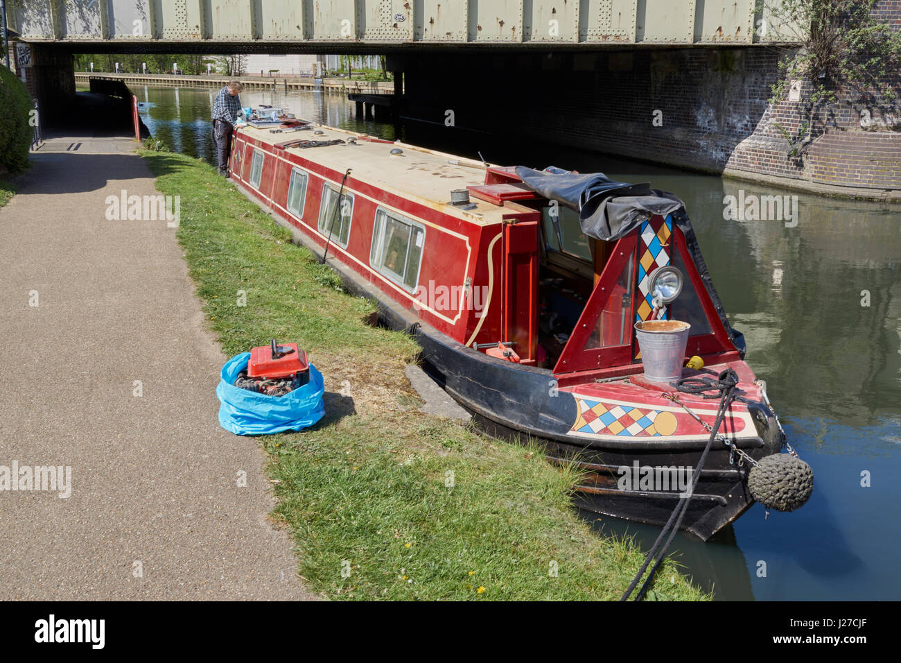 Man working on solar panel for canal boat - Stock Image