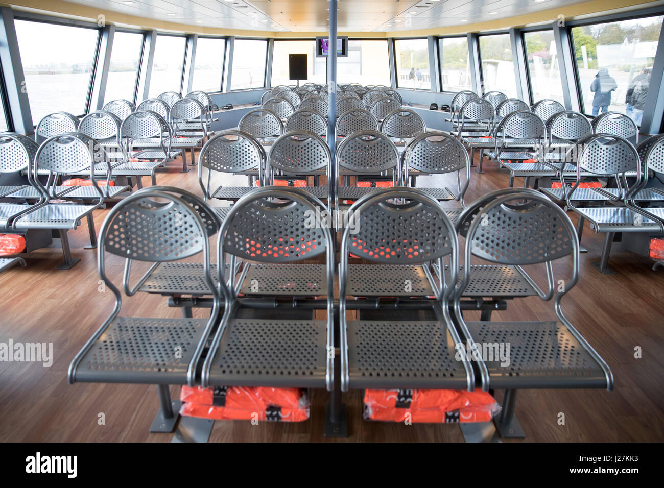 Empty passenger seats can be seen on the new HADAG ferry 'MS Elbphilharmonie' in Hamburg, Germany, 25 April - Stock Image