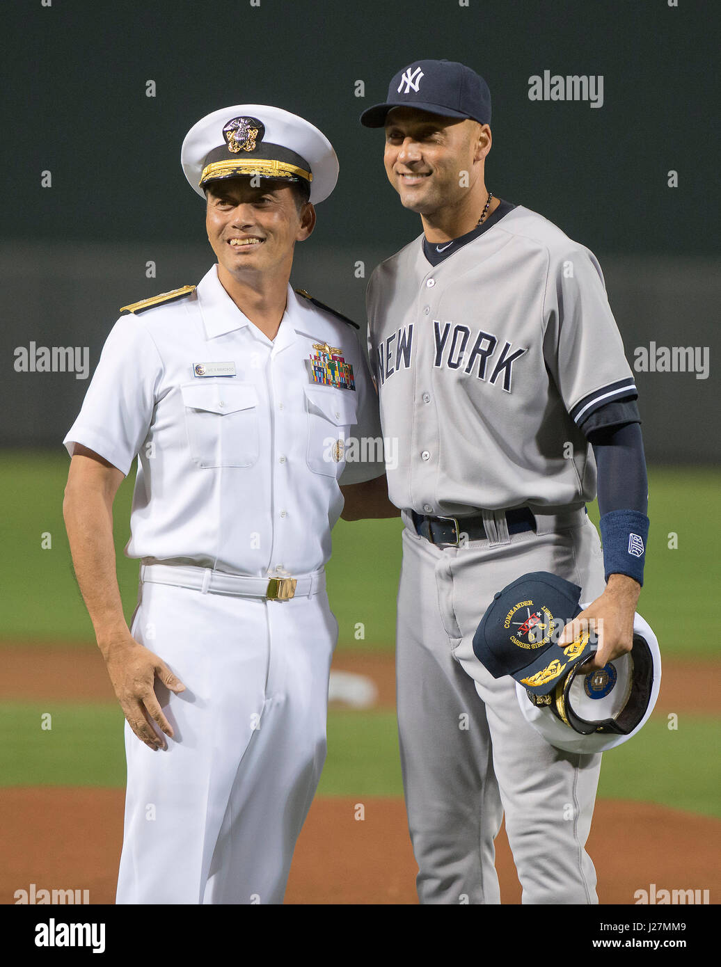 0ceeb00c29d New York Yankees shortstop Derek Jeter is presented a Captain s Hat by Rear  Admiral Victorino Mercado