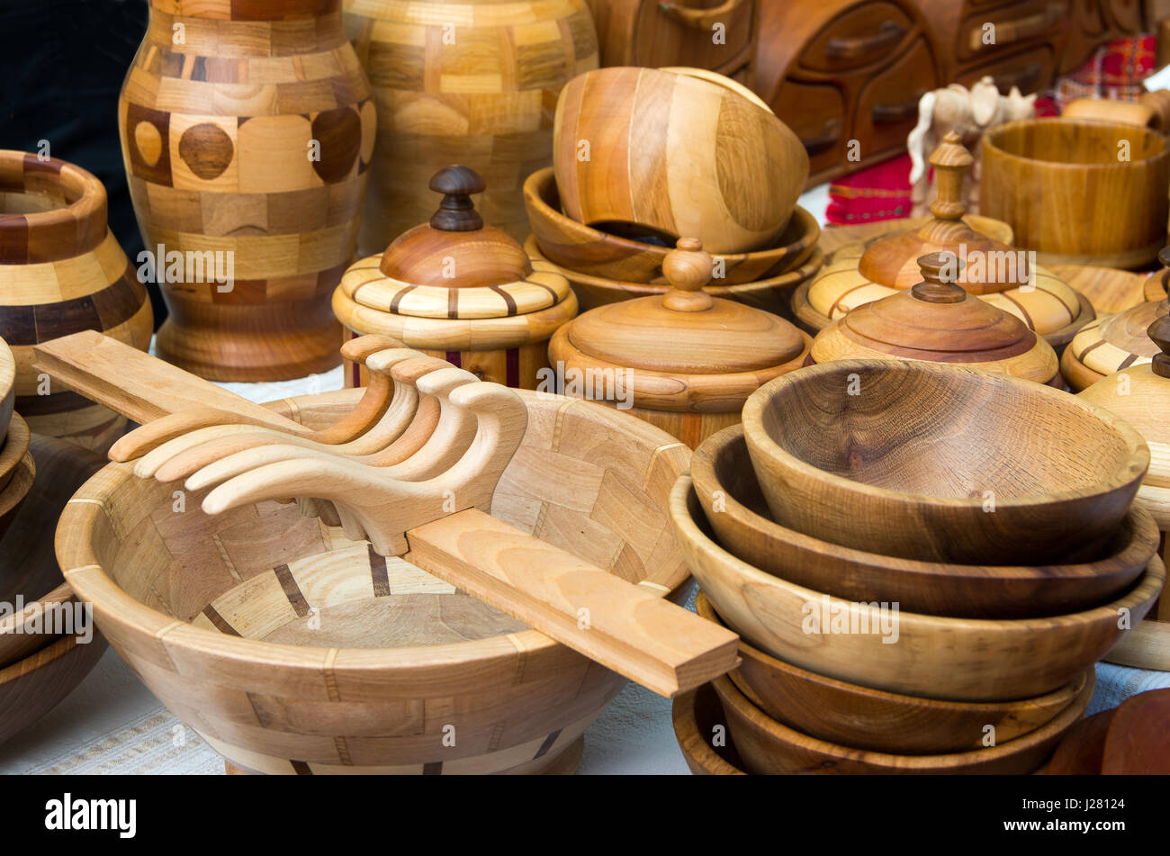Beautiful wooden household objects. Wooden kitchen utensils - Stock Image
