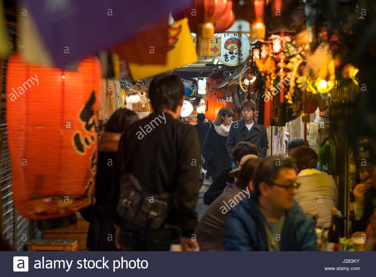 People walking in Ebisu Yokocho an izakaya arcade, Ebisu, Shibuya, Tokyo, Honshu, Japan Stock Photo