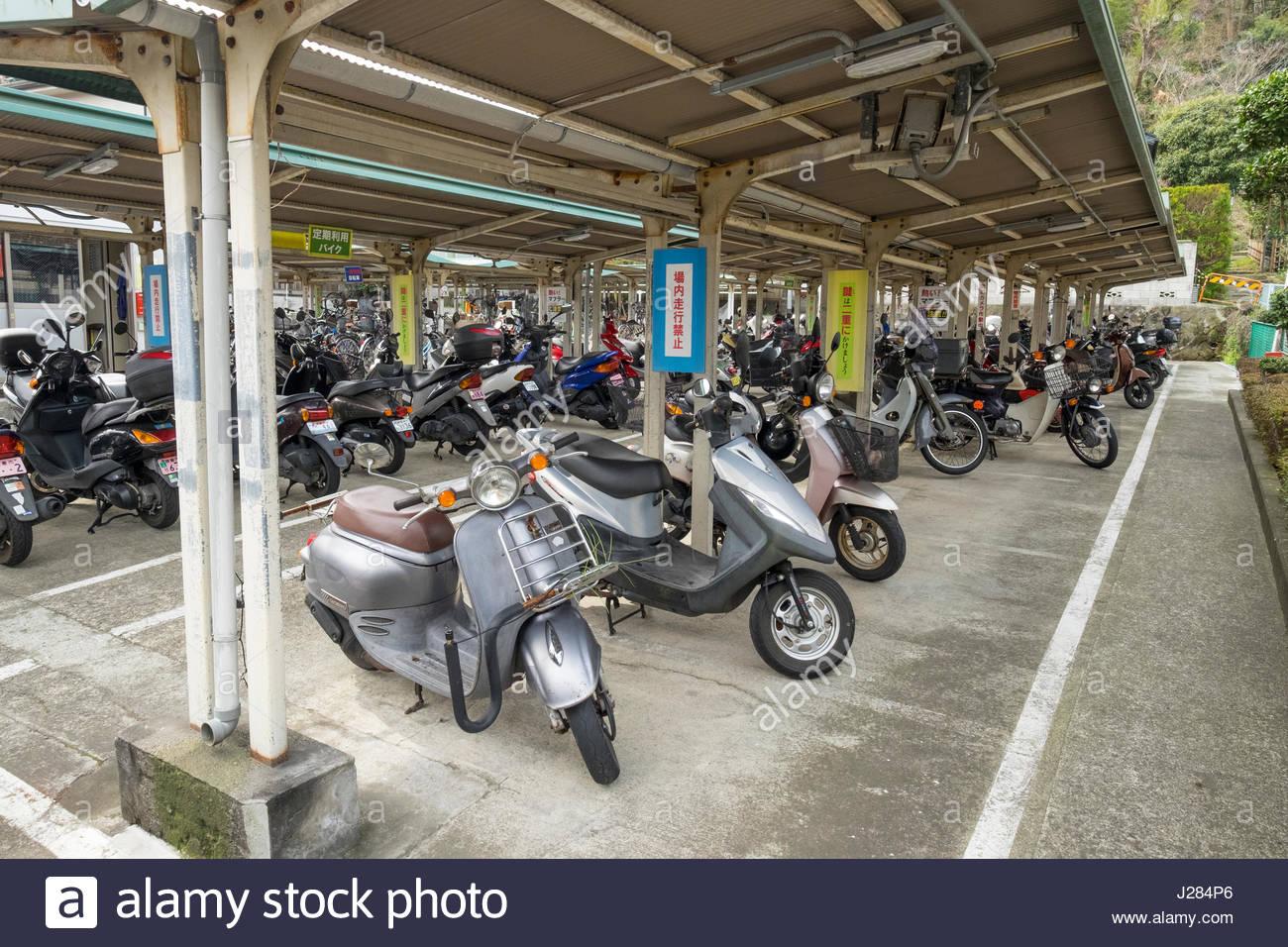 Covered commuter parking for motor scooters near Kita-Kamakura Station, Yamanouchi, Kamakura, Kanagawa Prefecture, - Stock Image